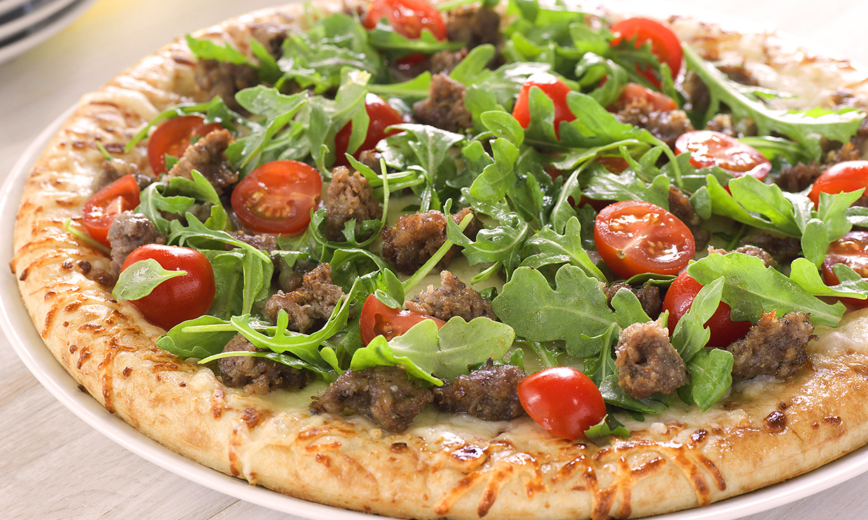 Sausage, Tomato and Arugula Pizza